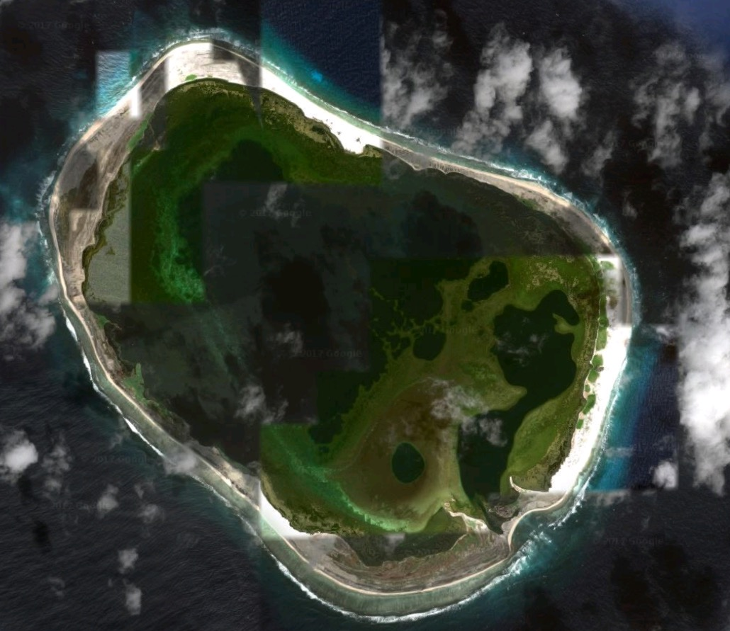 Clipperton Island, with the freshwater lagoon visible in the center (Google Maps).
