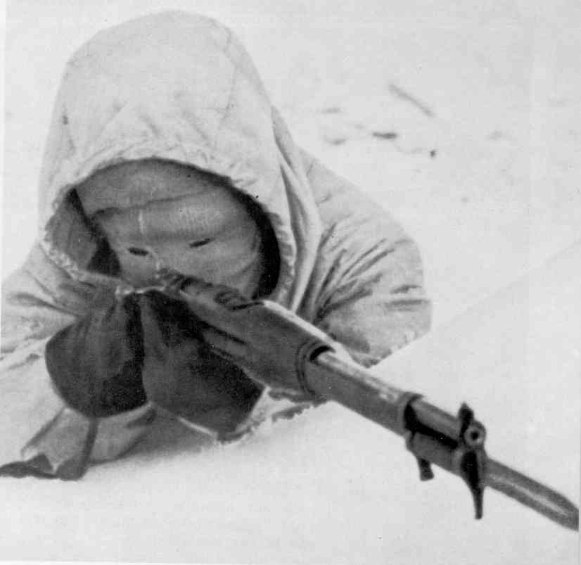 A contemporary Finnish sniper in winter gear, possibly Simo Häyhä